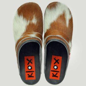 Klox_ Klogs mit schwarzer Sohle und geschecktem Fell